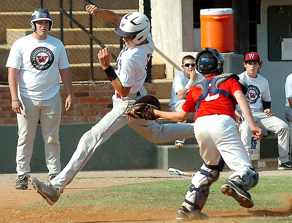 Alva catcher, Jack Louthan, tags out Kamdyn Taunton of Weatherford Sunday at David Allen Ballpark. (Staff Photo by BILLY HEFTON)