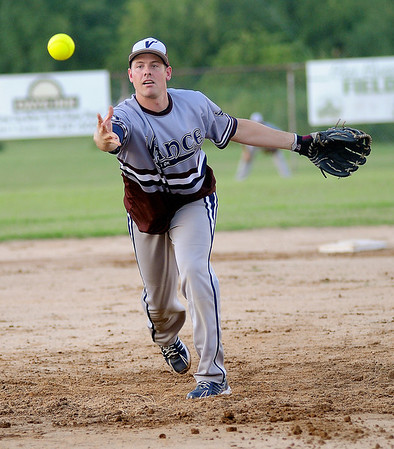 Vance AFB's John Stock pitches during a game at Kellet Ballpark Tuesday, July 30, 2013. Vance will play in the Class B state softball tournament at Kellet Ballpark Saturday. (Staff Photo by BONNIE VCULEK)