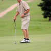 Lemuel Vance, from Pryor, watches his putt rim the cup during the OSGA Senior 4-Ball at Oakwood Country Club Tuesday, July 30, 2013. (Staff Photo by BONNIE VCULEK)