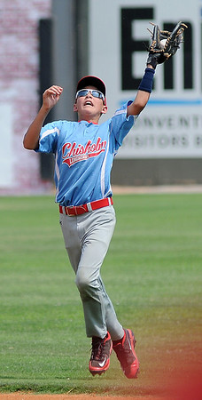 Chisholm's Scott Grebe snags a Leedey batter's hit in shallow right field during the Red Dirt State Tournament at David Allen Memorial Ballpark Saturday, July 6, 2013. (Staff Photo by BONNIE VCULEK)