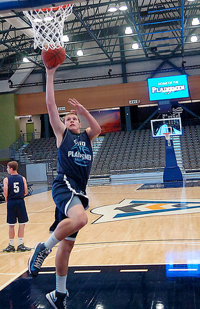 Brady Wilson of the Enid Plainsmen takes part in a shoot around Tuesday at the Enid Event Center. (Staff Photo by BILLY HEFTON)