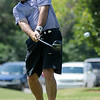 Oakwood's Matt Parrish concentrates as he tees off on No. 1 during the second round of the Enid Ryder Cup at Oakwood Country Club Saturday, July 13, 2013. (Staff Photo by BONNIE VCULEK)