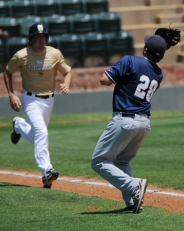 Enid Minors' Bates Enmeier (right) snags a pop-up by Southmoore Sabercats' Kalon Rodriguez (left) during the Connie Mack State Baseball Tournament at David Allen Memorial Ballpark Friday, July 19, 2013. (Staff Photo by BONNIE VCULEK)