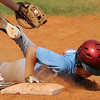 Chisholm's Mason McKee slides back to first during a game against the Leedey RBI's at the Red Dirt State Tournament at David Allen Memorial Ballpark Saturday, July 6, 2013. (Staff Photo by BONNIE VCULEK)