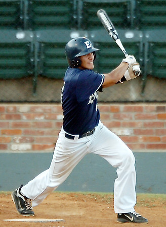 Enid's Junior Obeso hits the ball to right field against Woodward Tuesday at david Allen Ballpark. (Staff Photo by BILLY HEFTON)