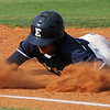 Enid Minors' Hunter Childs slides back to first during a game against the Oklahoma City Shockers Monday, July 1, 2013 at David Allen Memorial Ballpark. (Staff Photo by BONNIE VCULEK)