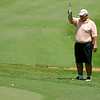 Bob Keiser aligns his putt on No. 11 green during the Senior 4-ball tournanent at Oakwood Country Club Monday, July 7, 2014. (Staff Photo by BONNIE VCULEK)