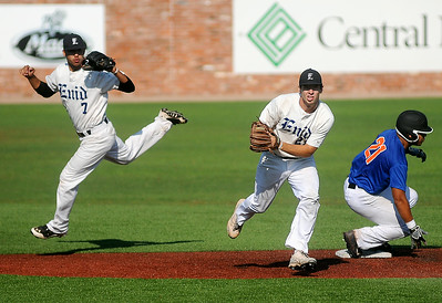 Enid Majors' Brady Kokojan snags a ball by second and throws to first as Xavier Sundman (left) backs up the play against the Oklahoma Fuel during the Connie Mack State Baseball Tournament at David Allen Memorial Ballpark Saturday, July 19, 2014. (Staff Photo by BONNIE VCULEK)