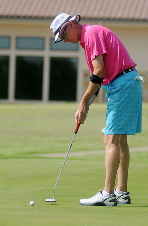 John Reese putts on the Par 4, 425 yard No. 9 hole during the Oklahoma Senior Golf Association State Fourball Tournament at Oakwood Country Club Tuesday, July 8, 2014. (Staff Photo by BONNIE VCULEK)