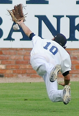 Enid Majors' Cole Floyd dives for a long ball in deep, center field during the Oklahoma Outlaws' 12-4 win at David Allen Memorial Ballpark Tuesday, July 8, 2014. (Staff Photo by BONNIE VCULEK)