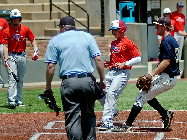 A Dallas Mustang batter scores from third after a wild pitch eludes OKC Sandlot 18's Colin Simpson during the Connie Mack Regional Baseball Tournament elimination game at David Allen Memorial Ballpark Saturday, July 26, 2014. (Staff Photo by BONNIE VCULEK)