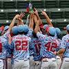 Members of the D-Bats Gallegos raise the championship trophy following the final out in the D-Bats 3-0 win over the Dallas Mustangs in the championship game of the Connie Mack regional tournament at David Allen Memorial Ballpark. (Staff Photo by BILLY HEFTON)