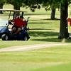 Meadowlake's Jay Betchan approaches No. 9 green as his teammate Josh Bugg watches during the second round of the Enid Ryder Cup at Meadowlake Golf Course Saturday, July 26, 2014. (Staff Photo by BONNIE VCULEK)