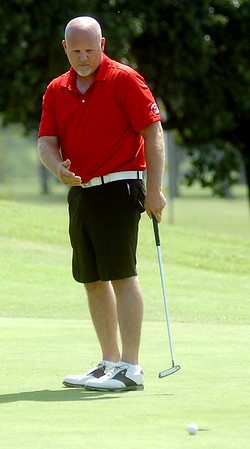 Meadowlake's Jay Betchan reacts as his putt rolls past the No. 9 hole during the second round of the Enid Ryder Cup at Meadowlake Golf Course Saturday, July 26, 2014. (Staff Photo by BONNIE VCULEK)