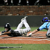 Enid's Cole Flpyd avoids the tag of Cherry Creek's Matt Malkin to score the Major's first run during the Connie Mack regional tornament Tuesday at David Allen Memorial Ballpark. (Staff Photo by BILLY HEFTON)
