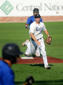 Enid Majors' Brady Kokojan snags a ball by second and throws to first against the Oklahoma Fuel during the Connie Mack State Baseball Tournament at David Allen Memorial Ballpark Saturday, July 19, 2014. (Staff Photo by BONNIE VCULEK)