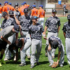 The Enid Majors relax for a few minutes after their 7-1 win over the Bulls at David Allen Memorial Ballpark Saturday, July 12, 2014. (Staff Photo by BONNIE VCULEK)
