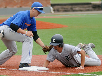 Enid Majors' Cole Floyd dives back to first before OKC Athletics' Trey Henley can make the tag during the Connie Mack State Baseball Tournament at David Allen Memorial Ballpark Friday, July 18, 2014. (Staff Photo by BONNIE VCULEK)