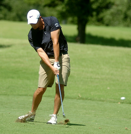 J. J. Fournier hits his approach on the No. 2 green, 416 yards away, during the first round of the Enid Ryder Cup at Oakwood Country Club Friday, July 25, 2014. (Staff Photo by BONNIE VCULEK)
