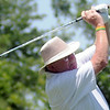 Rod Billings concentrates as he watches his ball sail down the No. 12 fairway during the Senior 4-ball tournament at Oakwood Country Club Monday, July 7, 2014. (Staff Photo by BONNIE VCULEK)