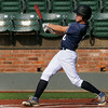 Enid's Connor Gregory singles against D-Bat during the opening game of the Connie Mack regional tournament Tuesday at David Allen Memorial Ballpark. (Staff Photo by BILLY HEFTON)