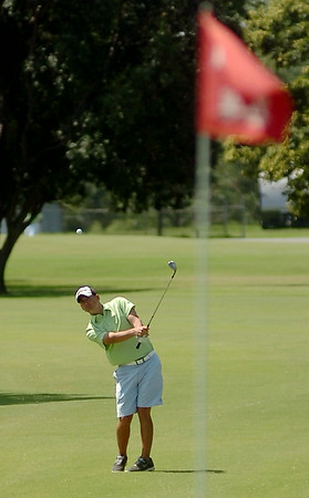 Oakwood Country Club's Josh Tobitt hits his approach toward the No. 9 green during the second round of the Enid Ryder Cup at the Meadowlake Golf Course Saturday, July 26, 2014. (Staff Photo by BONNIE VCULEK)