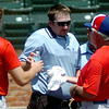 A Dallas Mustang player and head coach assist the home plate umpire after a foul tip struck his right ribs during the Connie Mack Regional Baseball Tournament at David Allen Memorial Ballpark Saturday, July 26, 2014. (Staff Photo by BONNIE VCULEK)