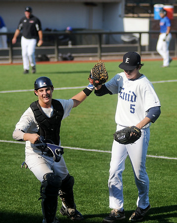 Enid Majors' Kros Bay and Cooper Skulzucek celebrate as the Majors' maintain a 2-1 lead over the OK Fuel during the Connie Mack State Baseball Tournament at David Allen Memorial Ballpark Saturday, July 19, 2014. (Staff Photo by BONNIE VCULEK)