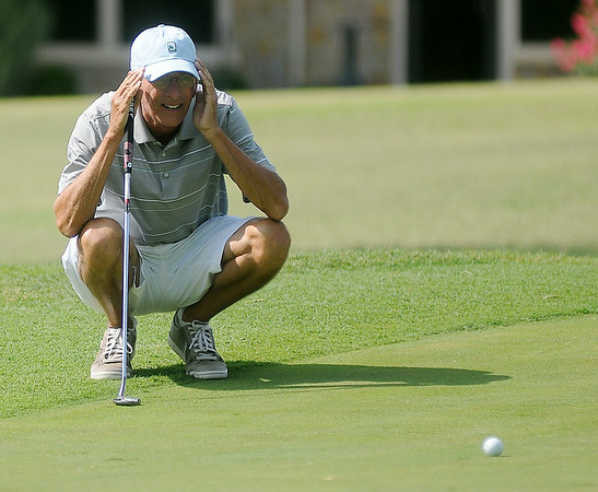 Gary Bonner lines up his putt on the Par 4, 425-yard, No. 9 green during the Oklahoma Senior Golf Association State Fourball Tournament at Oakwood Country Club Tuesday, July 8, 2014. (Staff Photo by BONNIE VCULEK)