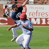 Enid's Jonny Chavez reaches for a high throw as Trent Clark of D-Bat steals second base during the opening game of the Connie Mack regional tournament Tuesday at David Allen Memorial Ballpark. (Staff Photo by BILLY HEFTON)
