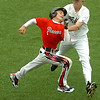 Enid's Matthew Mills tags out Austin McIntosh of the Oklahoma Racers Thursday during the Connie Mack state tournament Thursday at David Allen memorial Ballpark. (Staff Photo by BILLY HEFTON)