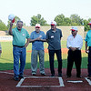 Players from the 1954 George E. Failing State Legion Championship team are introduced during the Connie Mack State Baseball Tournament at David Allen Memorial Ballpark Saturday, July 19, 2014. (Staff Photo by BONNIE VCULEK)
