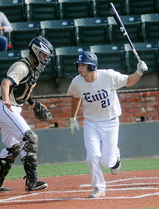 Enid Majors' Brady Kokojan spits as he takes a walk to first during a game against the OKC Sandlot 18s at the Connie Mack State Baseball Tournament at David Allen Memorial Ballpark Saturday, July 19, 2014. (Staff Photo by BONNIE VCULEK)