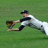 Elliott Holden of the Enid Minors makes a diving catch against the Enid Majors Friday during the Connie Mack state tournament. (Staff Photo by BILLY HEFTON)