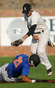 OK Fuel's Ryan Lujen slides safely under Enid Majors' Xavier Sundman during the Connie Mack State Baseball Tournament at David Allen Memorial Ballpark Saturday, July 19, 2014. OK Fuel won the ballgame 5-2, eliminating the Enid Majors. (Staff Photo by BONNIE VCULEK)