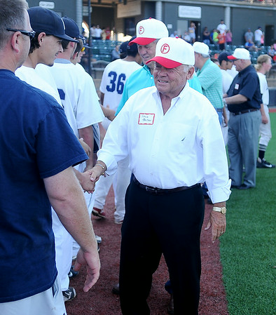 Enid Majors and coaches congratulate members of the 1954 George E. Failing American Legion team at David Allen Memorial Ballpark on the team's 60th anniversary of their State Legion Championship. (Staff Photo by BONNIE VCULEK)
