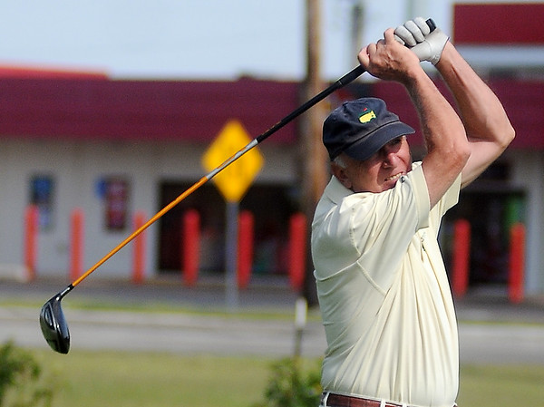Rob Stallings tees off during the Oklahoma Senior Golf Association State Fourball Tournament at Oakwood Country Club Tuesday, July 8, 2014. (Staff Photo by BONNIE VCULEK)