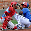 D-Bats Gallegos, catcher, Braden Williams, blocks the plate to tag out Antonio Santillan, of the Dallas Mustangs, during the D-Bats 3-0 win over the Mustangs in the championship game of the Connie Mack regional tournament at David Allen Memorial Ballpark. (Staff Photo by BILLY HEFTON)