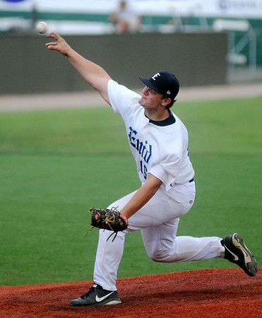 Enid Majors' Garrett Beier pitches in relief to an Oklahoma Outlaw batter during the Outlaws' 12-4 win at David Allen Memorial Ballpark Tuesday, July 8, 2014. (Staff Photo by BONNIE VCULEK)