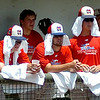 Dallas Mustangs sport wet towels as they try to keep cool in their dug out as temperatures climb over 104 degrees during the Connie Mack Regional Baseball Tournament at David Allen Memorial Ballpark Saturday, July 26, 2014. (Staff Photo by BONNIE VCULEK)