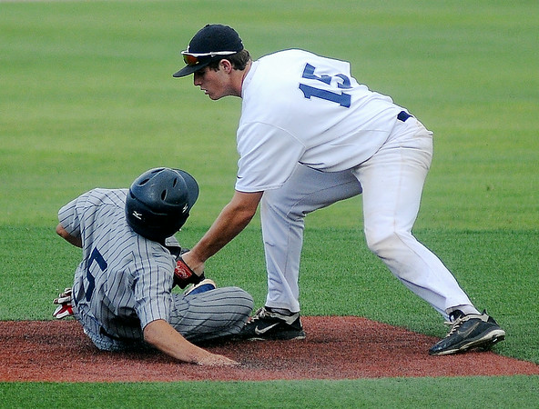 Enid Majors' Braden Rogers makes the tag at second against the Oklahoma Outlaws at David Allen Memorial Ballpark. The Outlaws won 12-4. (Staff Photo by BONNIE VCULEK)
