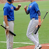 Two OKC Athletics players celebrate another run against the Enid Majors during the Connie Mack State Baseball Tournament at David Allen Memorial Ballpark Friday, July 18, 2014. (Staff Photo by BONNIE VCULEK)