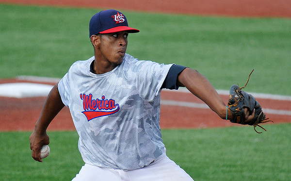 Jonathan Stroman of the Albuquerque Cage Rats delivers a pitch against Frozen Ropes Badarack during the opening game of the Connie Mack Regional Tournament Tuesday July 19, 2016 at David Allen Ballpark. (Billy Hefton / Enid News & Eagle)