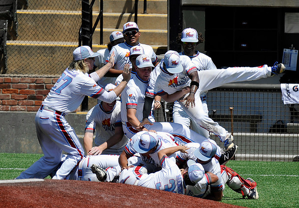 D-Bat players celebrate after defeating TX Stix Red 8-0 to win the Connie Mack Regional Tournament Sunday July 24, 2016 at David Allen Ballpark. (Billy Hefton / Enid News & Eagle)
