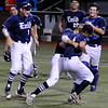 Jonny Chavez tackles Cole Bergdall following Enid Majors 6-4 win over the Woodward 18s in the Connie Mack state championship game Saturday July 16, 2016 at David Allen Ballpark. (Billy Hefton / Enid News & Eagle)