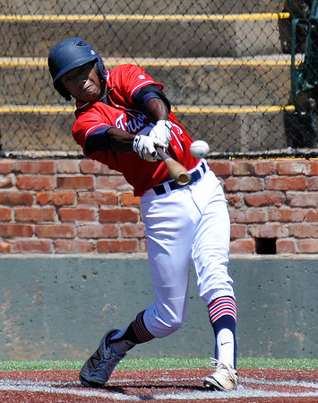 Woodward's Keyshawn Smith connects on a single against TX Stix Red during an elimnation game in the Connie Mack Regional Tournament Friday July 22, 2016 at David Allen Ballpark. (Billy Hefton / Enid News & Eagle)