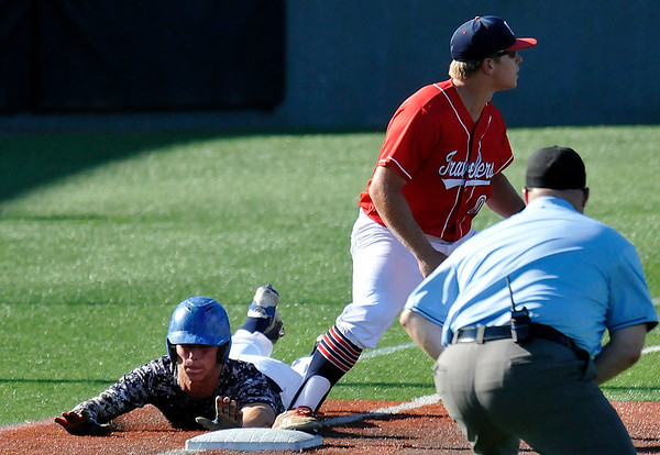 Enid Majors' Tabor Johns dives to first base against Woodward during an elimination game of the Connie Mack Regional Tournament Thursday July 21, 2016 at David Allen Ballpark. (Billy Hefton / Enid News & Eagle)