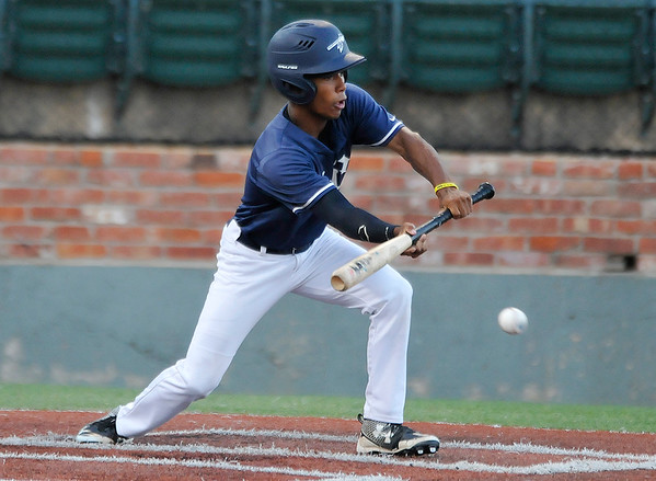 Enid Majors' Bryan Pacheco bunts for a base hit against the OKC Broncos during the opening round of the Connie Mack State Tournament Wednesday July 13, 2016 at David ALlen Ballpark. (Billy Hefton / Enid News & Eagle)