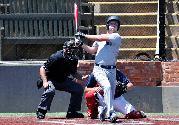 Enid Majors' Wesley O'Neill hits a three run home run against the Woodward 17 during an elimination game in the Connie Mack State Tournament Friday July 15, 2016 at David ALlen Ballpark. (Billy Hefton / Enid News & Eagle)