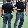 Umpires remove an illegal bat from the opening game of the Connie Mack Regional Tournament Tuesday July 19, 2016 at David Allen Ballpark. (Billy Hefton / Enid News & Eagle)